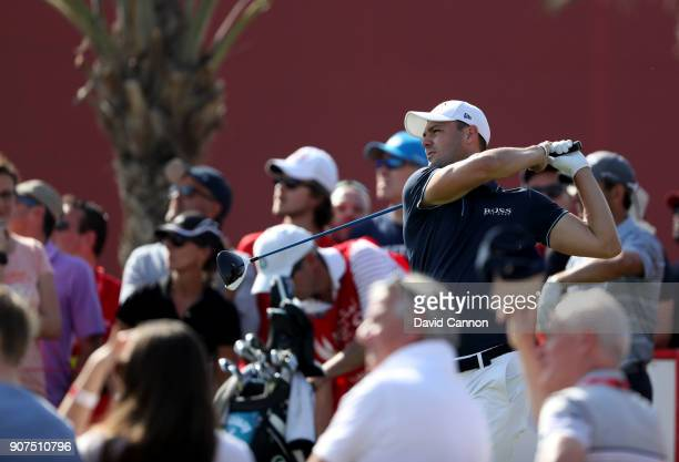 Martin Kaymer of Germany plays his tee shot on the par 4 14th hole during the third round of the 2018 Abu Dhabi HSBC Golf Championship at the Abu...