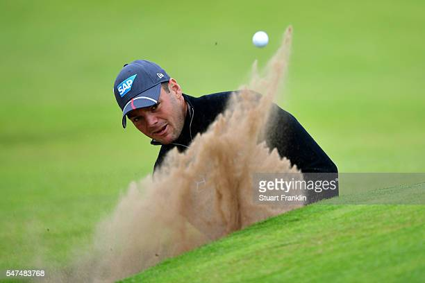 Martin Kaymer of Germany plays his third shot from a bunker on the 4th hole during the second round on day two of the 145th Open Championship at...