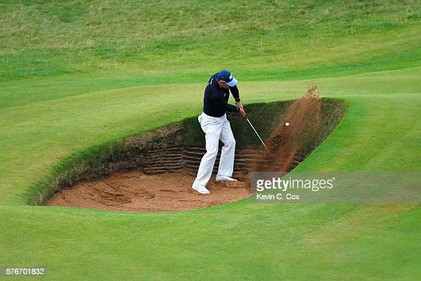 Martin Kaymer of Germany plays his third shot from a bunker on the 4th hole during the final round on day four of the 145th Open Championship at...