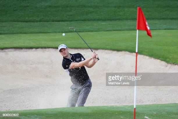 Martin Kaymer of Germany plays his third shot from a bunker on the second hole during round one of the Abu Dhabi HSBC Golf Championship at Abu Dhabi...