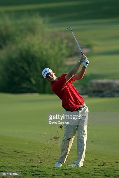 Martin Kaymer of Germany plays his third shot on the 18th hole during the first round of the Dubai World Championship on the Earth Course at Jumeirah...