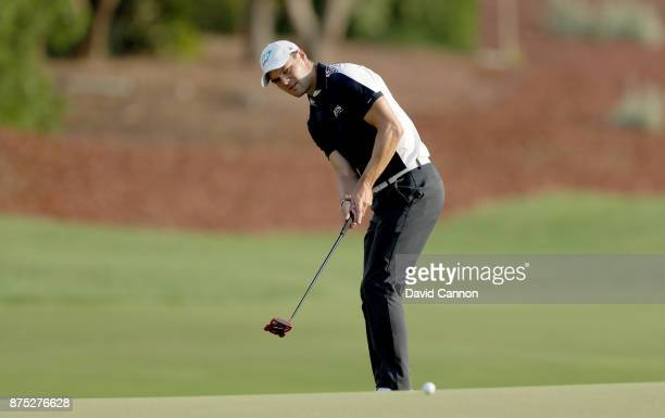 Martin Kaymer of Germany plays his third shot on the 18th hole during the second round of the DP World Tour Championship on the Earth Course at...