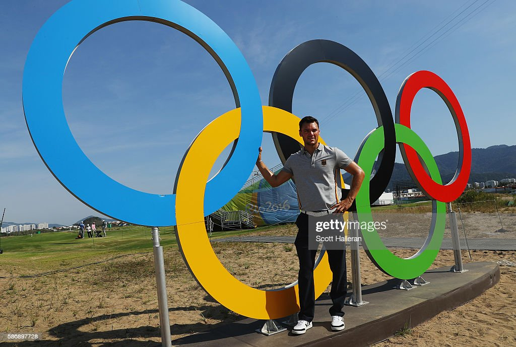 Martin Kaymer of Germany poses near a set of Olympic rings on a practice day during Day 2 of the Rio 2016 Olympic Games at Olympic Golf Course on August 7, 2016 in Rio de Janeiro, Brazil.