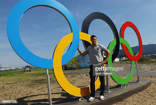 Martin Kaymer of Germany poses near a set of Olympic rings on a practice day during Day 2 of the Rio 2016 Olympic Games at Olympic Golf Course on...