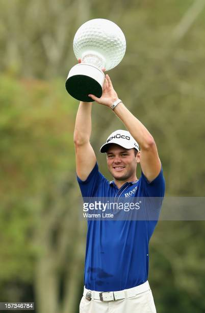 Martin Kaymer of Germany poses with the trophy after winning the Nedbank Golf Challenge at the Gary Player Country Club on December 2, 2012 in Sun...