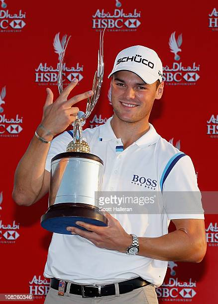 Martin Kaymer of Germany poses with the trophy on the 18th green after winning the 2011 Abu Dhabi HSBC Golf Championship at the Abu Dhabi Golf Club...