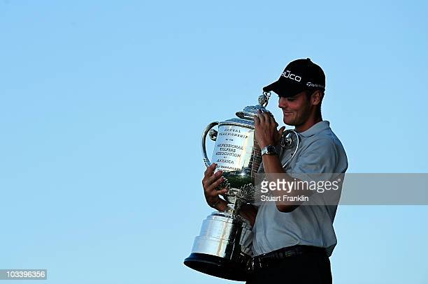 Martin Kaymer of Germany poses with the Wanamaker Trophy after defeating Bubba Watson during the three-hole aggregate playoff at the 92nd PGA...
