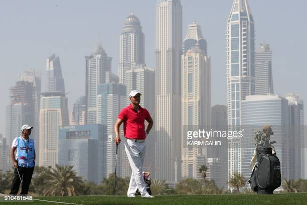 Martin Kaymer of Germany prepares to play a shot during the round two of the Dubai Desert Classic at Emirates Golf Club on January 26 in Dubai / AFP...