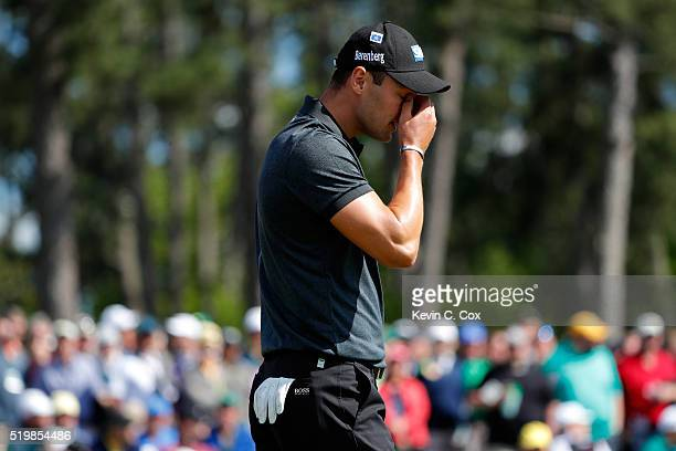 Martin Kaymer of Germany reacts after a missed putt on the 18th green during the second round of the 2016 Masters Tournament at Augusta National Golf...