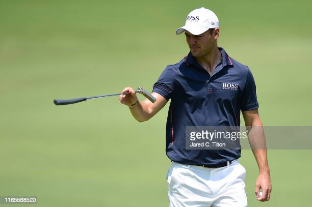 Martin Kaymer of Germany reacts following a putt attempt on the 12th green during the first round of the Wyndham Championship at Sedgefield Country...