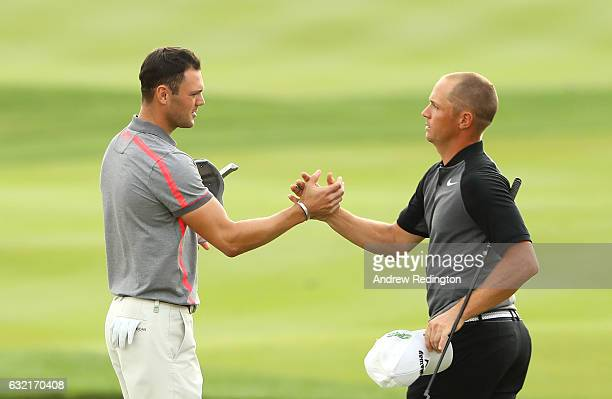 Martin Kaymer of Germany shakes hands with Alex Noren of Sweden on the 18th green during the second round of the Abu Dhabi HSBC Championship at the...