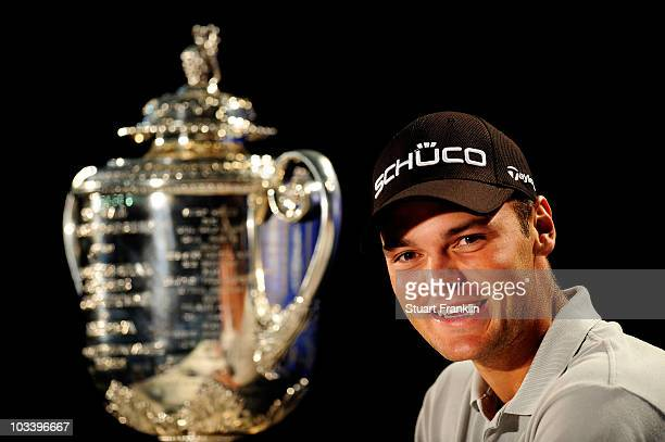 Martin Kaymer of Germany smiles as he looks at the Wanamaker Trophy during a press conference after winning the 92nd PGA Championship on the Straits...