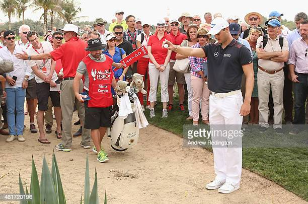 Martin Kaymer of Germany takes a drop on the ninth hole during the final round of the Abu Dhabi HSBC Golf Championship at the Abu Dhabi Golf Cub on...