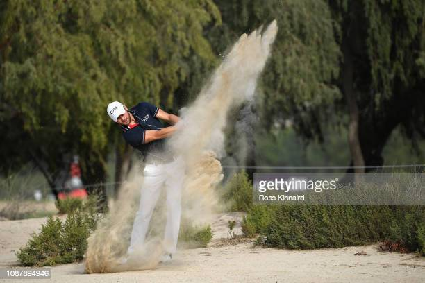 Martin Kaymer of Germany takes his second shot on hole fourteen from a bunker during Day One of the Omega Dubai Desert Classic at Emirates Golf Club...