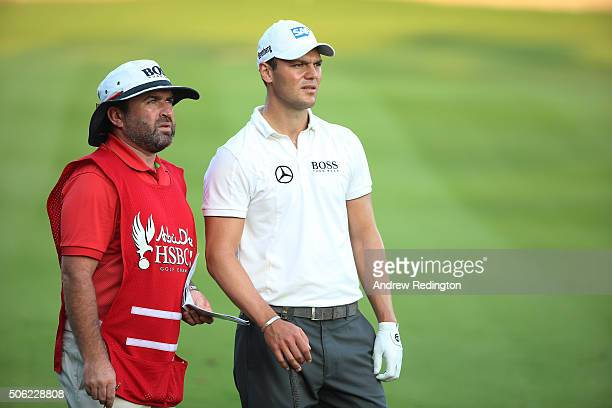 Martin Kaymer of Germany talks to his caddie Craig Connelly on the 10th hole during the second round of the Abu Dhabi HSBC Golf Championship at the...