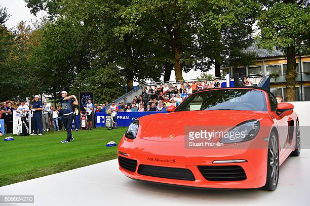 Martin Kaymer of Germany tees off next to Porsche during the second round on day two of the Porsche European Open at Golf Resort Bad Griesbach on...