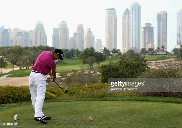 Martin Kaymer of Germany tees off on the eighth hole during the final round of the Dubai Desert Classic on the Majilis Course at the Emirates Golf...