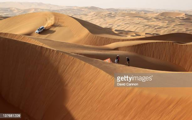 Martin Kaymer of Germany the defending champion of the HSBC Abu Dhabi Championship is interrupted in the photoshoot by a desert safari vehicle as he...