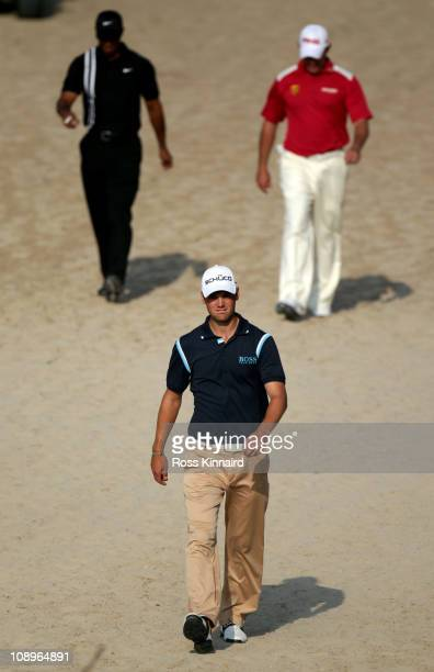 Martin Kaymer of Germany Tiger Woods of the USA and Lee Westwood of England on the 14th hole during the first round the Omega Dubai Desert Classic on...