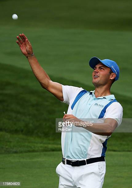 Martin Kaymer of Germany tosses his golf ball into the gallery after holing a shot for eagle on the par 5 13th hole during the first round of the...