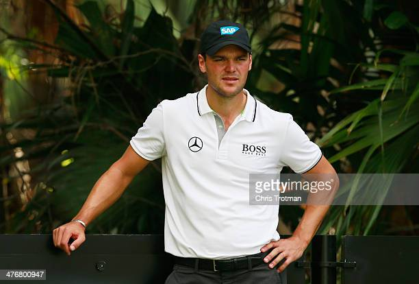 Martin Kaymer of Germany waits on a tee during a practice round prior to the start of the World Golf Championships-Cadillac Championship at Trump...
