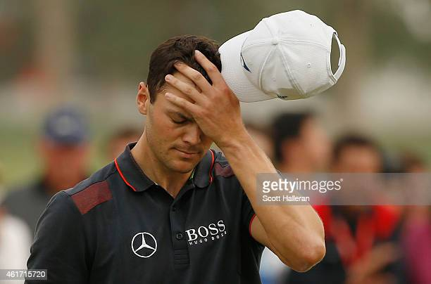 Martin Kaymer of Germany waits on the 18th green during the final round of the Abu Dhabi HSBC Golf Championship at the Abu Dhabi Golf Cub on January...
