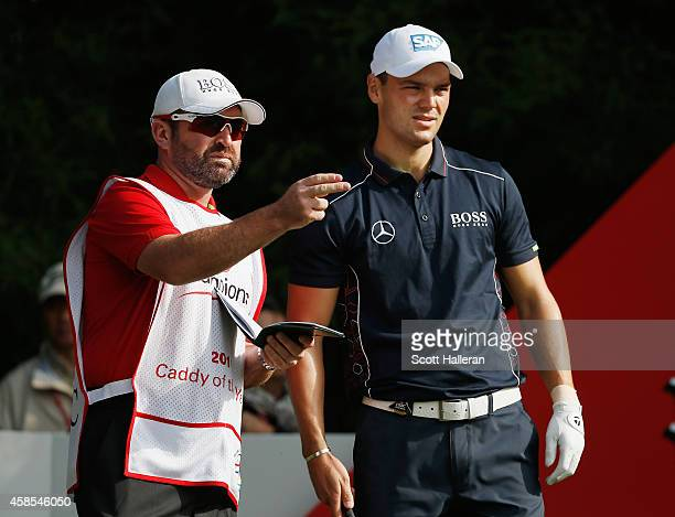 Martin Kaymer of Germany waits with his caddie Craig Connelly on the second tee during the second round of the WGC HSBC Champions at the Sheshan...