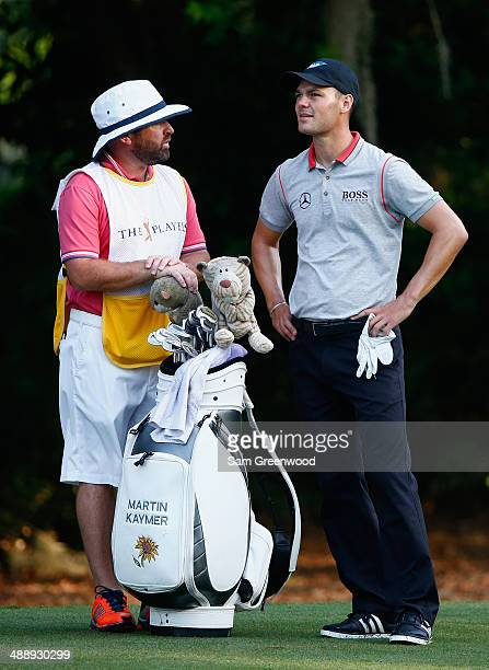 Martin Kaymer of Germany waits with his caddie Craig Connelly on the second holeduring the second round of THE PLAYERS Championship on The Stadium...