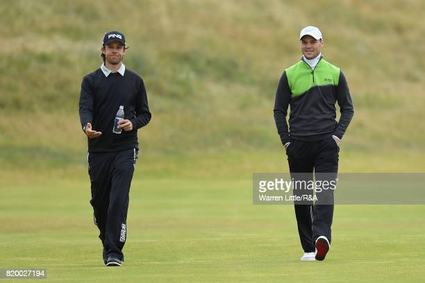 Martin Kaymer of Germany walks down the 2nd hole with Aaron Baddeley of Australia during the second round of the 146th Open Championship at Royal...