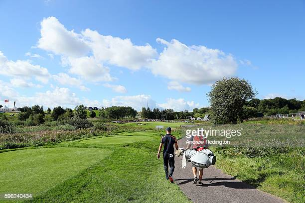 Martin Kaymer of Germany walks down the 2nd hole with caddie Craig Connelly during the third round of Made in Denmark at Himmerland Golf Spa Resort...