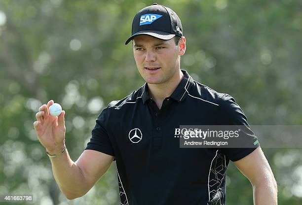 Martin Kaymer of Germany waves to the crowd after his birdie on the sixth hole during the third round of the Abu Dhabi HSBC Golf Championship at the...