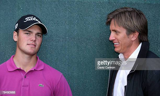 Martin Kaymer of Germany with Johan Elliot his manager after the final round of the Dubai Desert Classic on the Majilis Course at the Emirates Golf...