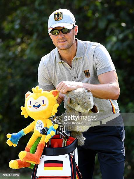 Martin Kaymer of Germany with the Olympic mascott during a practice round on Day 2 of the Rio 2016 Olympic Games at Olympic Golf Course on August 7...