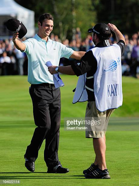 Martin Kaymer of Germay celebrates winning with his caddie Craig Connelly on the 18th hole during the final round of The KLM Open Golf at The...