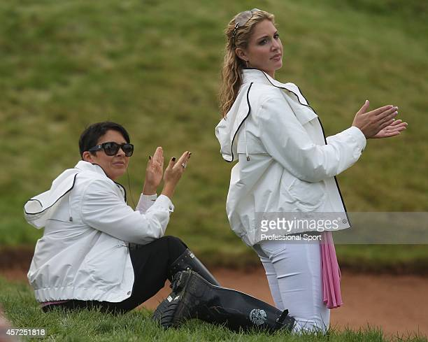 Martin Kaymer's partner Allison Micheletti and Laura Westwood watch the action on the 18th green during the 2010 Ryder Cup at the Celtic Manor Resort...