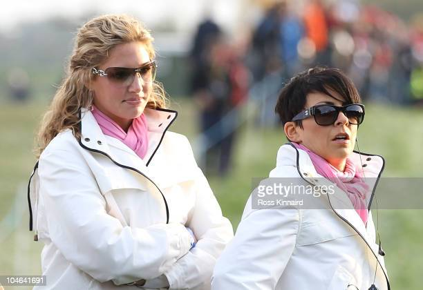 Martin Kaymer's partner Allison Micheletti and Laurae Westwood watch the action during the rescheduled Morning Fourball Matches during the 2010 Ryder...