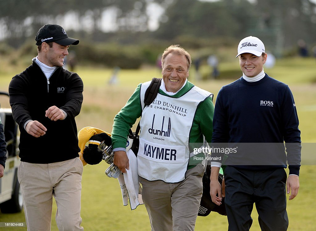 Martin Kayner, his father Horst Kaymer and brother Philip Kaymer on the 18th green during the first round of the Alfred Dunhill Links Championship on the Championship Links on September 26, 2013 in Carnoustie, Scotland.