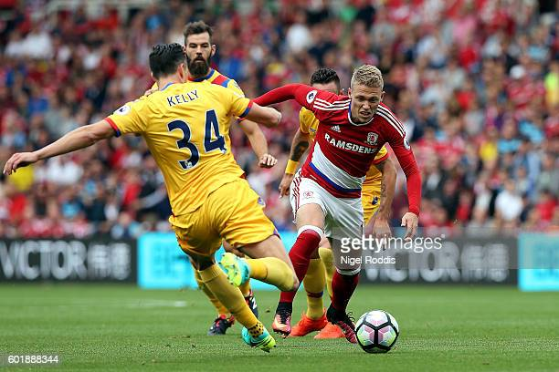 Martin Kelly of Crystal Palace and Adam Forshaw of Middlesbrough battle for possession during the Premier League match between Middlesbrough and...