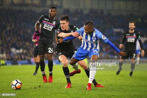 Martin Kelly of Crystal Palace and Jose Izquierdo of Brighton and Hove Albion battle for the ball during The Emirates FA Cup Third Round match...