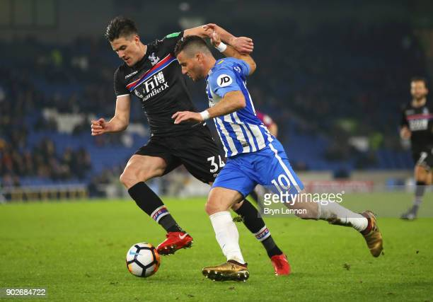 Martin Kelly of Crystal Palace and Tomer Hemed of Brighton and Hove Albion battle for the ball during The Emirates FA Cup Third Round match between...