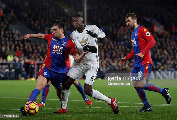 Martin Kelly of Crystal Palace attempts to stop Paul Pogba of Manchester United from getting through on goal during the Premier League match between...