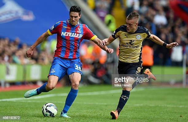 Martin Kelly of Crystal Palace battles for the ball with Jamie Vardy of Leicester City during the Barclays Premier League match between Crystal...