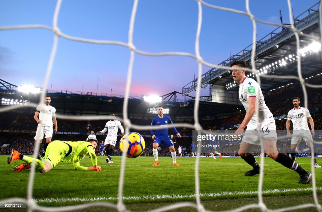 Martin Kelly of Crystal Palace scores a own goal for Chelsea second goal of the game during the Premier League match between Chelsea and Crystal Palace at Stamford Bridge on March 10, 2018 in London, England.