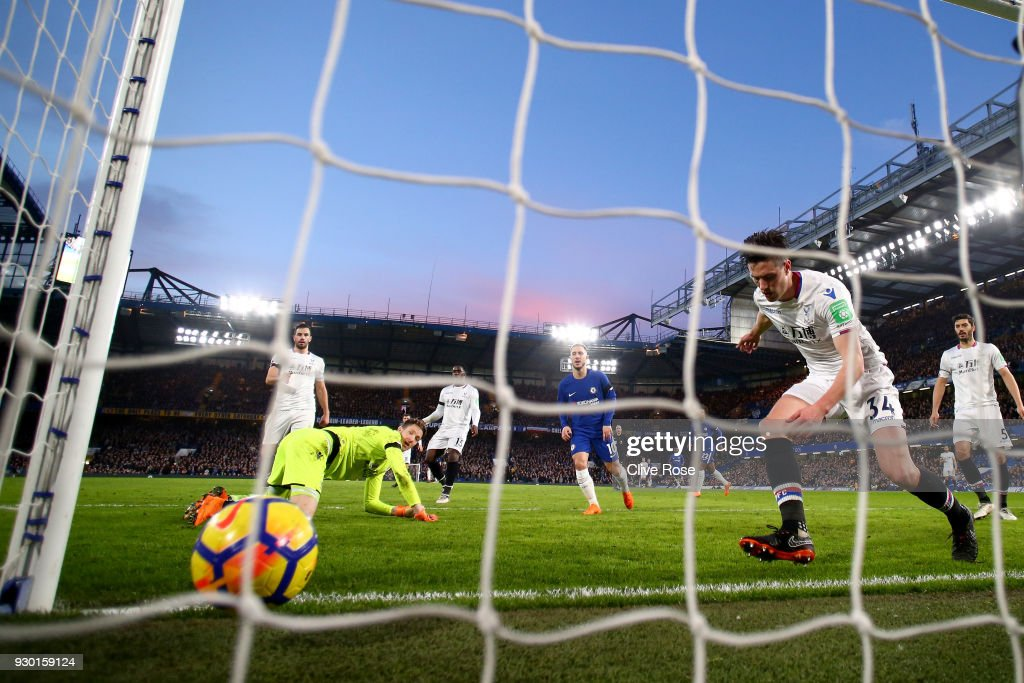 Martin Kelly of Crystal Palace scores a own goal for Chelsea second goal of the game during the Premier League match between Chelsea and Crystal Palace at Stamford Bridge on March 10, 2018 in London, England