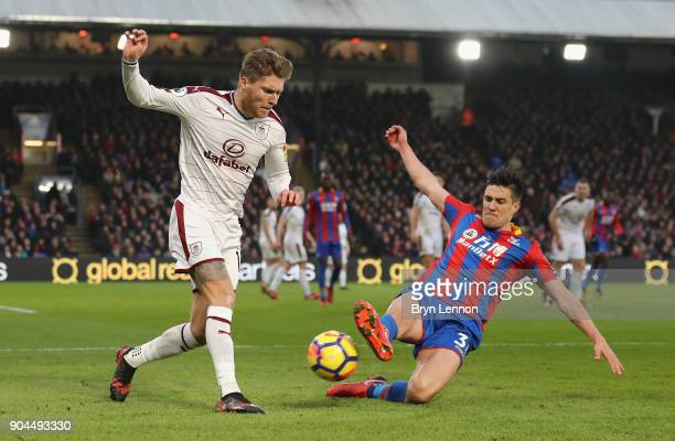 Martin Kelly of Crystal Palace tackles Jeff Hendrick of Burnley during the Premier League match between Crystal Palace and Burnley at Selhurst Park...