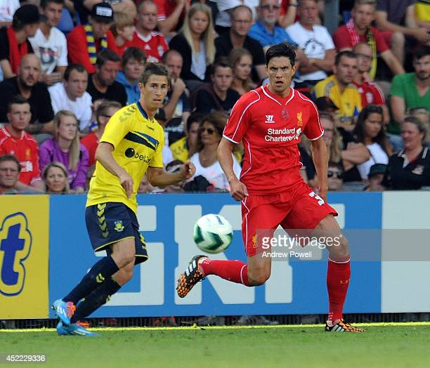 Martin Kelly of Liverpool competes with Alexander Szymanowski of Brondby IF during the Preseason friendly match between Brondby IF and Liverpool FC...