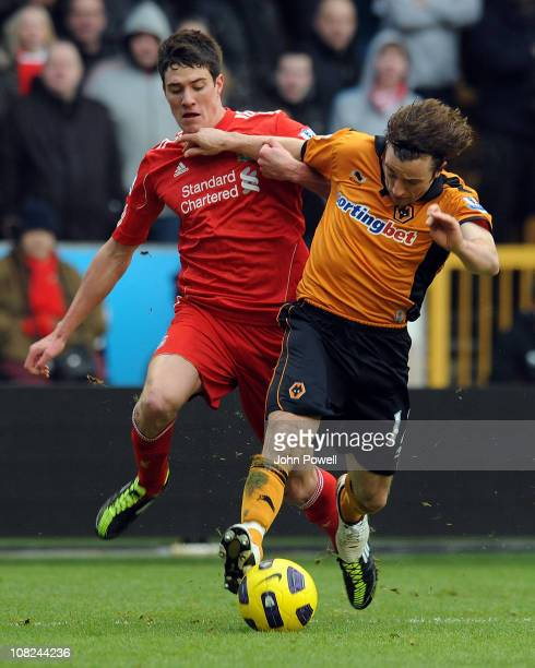 Martin Kelly of Liverpool competes with Stephen Hunt of Wolverhampton Wanderers during a Barclays Premier League match between Wolverhampton...