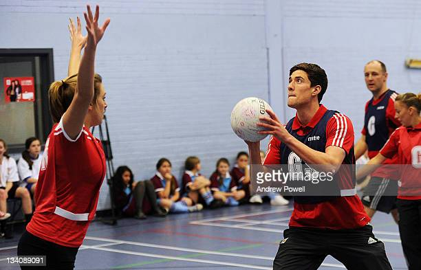 Martin Kelly of Liverpool FC in action during an exhibition netball game with women from the LFC Foundation watched by the England Netball team at...