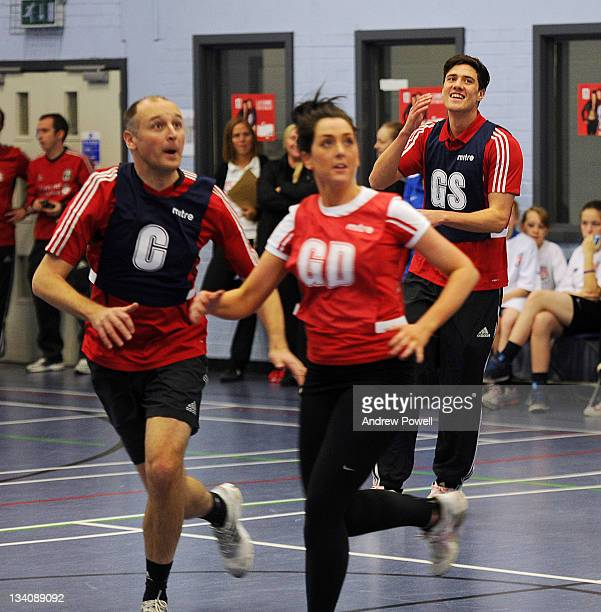Martin Kelly of Liverpool FC smiles during an exhibition netball game with women from the LFC Foundation watched by the England Netball team at...