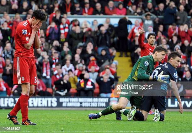 Martin Kelly of Liverpool is dejected after Wojciech Szczesny of Arsenal saves his shot during the Barclays Premier League match between Liverpool...